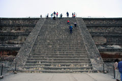 Mexico City, Mexico - November 22, 2015: View up the steps of a ruin at Teotihuacan in Mexico City, with people climbing up to the Stock Photography