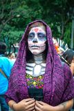 Mexico City, Mexico, ; October 26 2016: Portrait of a woman in disguise at the Day of the Dead parade in Mexico City. Portrait of a woman in disguise at the Day stock image