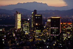 Mexico city at sunset time. MEXICO CITY,MEXICO-SEPTEMBER 14,2016: Aerial view of mexico city downtown skyscrappers at sunset time before night Royalty Free Stock Photos
