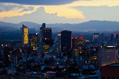 Mexico city at sunset time. MEXICO CITY,MEXICO-SEPTEMBER 14,2016: Aerial view of mexico city downtown skyscrappers at sunset time before night Stock Photo