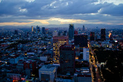 Mexico city at sunset time. MEXICO CITY,MEXICO-SEPTEMBER 14,2016: Aerial view of mexico city at sunset time before night Stock Image