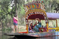Mexico City. A trajinera boat is seen in the canal at Xochimilco on March 21, 2014 in Mexico City Royalty Free Stock Images