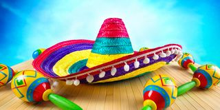Mexico.Colored sombrero and maracas on a wooden background. Colored sombrero and maracas on a wooden background.Mexico royalty free stock images