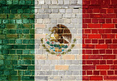Mexico flag on a brick wall. Mexican flag on an old brick wall background royalty free stock photos