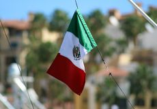 Mexico flag in sailing boating in ocean, ship at sea close up high quality image luxury experience Royalty Free Stock Photo