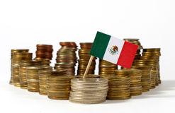Mexico flag with stack of money coins. Mexico flag waving with stack of money coins stock photo