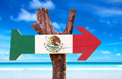 Mexico Flag wooden sign with a beach on background Stock Images