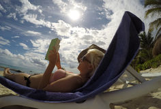 Mexico girl beach chilling read book sun palm Royalty Free Stock Images