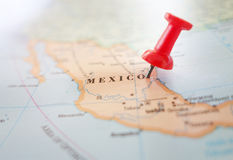 Mexico map location. Closeup of a map of Mexico with red thumbtack royalty free stock photography