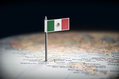 Mexico marked with a flag on the map.  royalty free stock photography