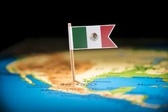 Mexico marked with a flag on the map.  stock images