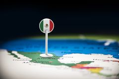 Mexico marked with a flag on the map.  royalty free stock photo
