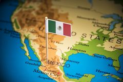 Mexico marked with a flag on the map.  stock photo