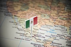 Mexico marked with a flag on the map.  stock photos