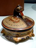 Mexico Maya art acient pot with dug head statue royalty free stock photo