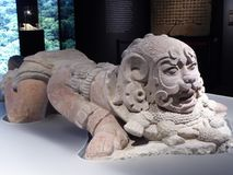 Mexico Maya art acient statue lying puma. God Stock Photos