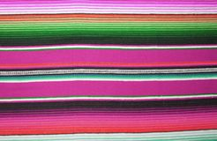 Mexican poncho background blanket cinco de mayo Mexico traditional rug poncho fiesta background with stripes copy space royalty free stock photo