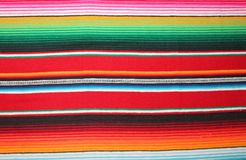 Mexican poncho background blanket cinco de mayo Mexico traditional rug poncho fiesta background with stripes copy space royalty free stock image