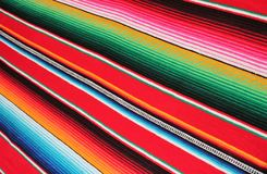 Poncho Mexico Mexican serape background traditional cinco de mayo rug fiesta with stripes. Poncho Mexican background serape Mexico traditional cinco de mayo rug royalty free stock photos