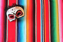 cinco de mayo poncho skull fiesta background with stripes stock photography