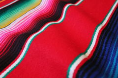 Poncho Mexico Mexican serape background traditional cinco de mayo rug fiesta background with stripes. Poncho Mexico Mexican serape background traditional cinco stock photography