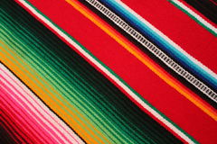 Poncho background Mexico Mexican traditional cinco de mayo rug poncho fiesta background with stripes. Poncho background Mexican serape Mexico traditional cinco Stock Image