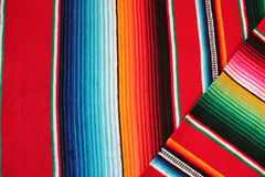 Poncho Mexico Mexican background serape traditional cinco de mayo rug poncho fiesta background with stripes. Poncho background Mexican Mexico serape traditional royalty free stock image