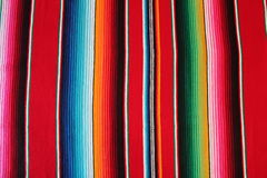 Poncho mexican Mexico background serape traditional cinco de mayo rug poncho fiesta background with stripes. Copy space Royalty Free Stock Photo