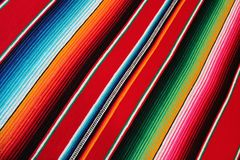 Poncho Mexican background Mexico traditional cinco de mayo rug poncho fiesta background with stripes. Poncho Mexican Mexico background cinco de mayo fiesta stock images