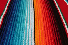 Mexico Mexican traditional cinco de mayo rug poncho fiesta background with stripes. Mexico traditional cinco de mayo rug poncho fiesta background with stripes stock photography