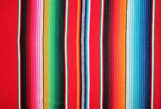 Poncho Mexico Mexican traditional cinco de mayo rug poncho fiesta background with stripes. Poncho Mexican Mexico traditional cinco de mayo rug poncho fiesta royalty free stock photos