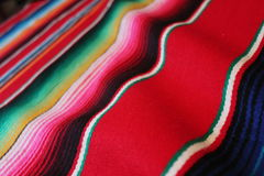 Mexico Mexican traditional cinco de mayo rug poncho fiesta background with stripes. Mexico traditional cinco de mayo rug poncho fiesta background with stripes
