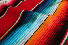 Mexico Mexican traditional cinco de mayo rug poncho fiesta background with stripes. Mexico traditional cinco de mayo rug poncho fiesta background with stripes Royalty Free Stock Photography