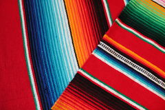 Mexico Mexican traditional cinco de mayo rug poncho fiesta background with stripes Stock Photo