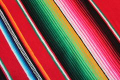 Mexico Mexican traditional cinco de mayo rug poncho fiesta background with stripes Royalty Free Stock Image