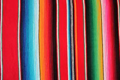 Mexico Mexican traditional cinco de mayo rug poncho fiesta background with stripes Royalty Free Stock Photography