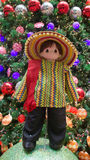 Mexico national custome. A doll dressed in Mexican national custome with the Christmas tree and Christmas balls in the background.  Photo taken on November 14th Stock Photo