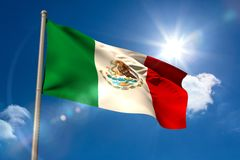 Mexico national flag on flagpole. Mexico national flag on blue sky background Royalty Free Stock Image