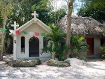 Mexico: Nuevo Durango white Catholic church exterior. Small Mexican village white Catholicchurch in Nuevo Durango, Quintana Roo with papel picado paper banners stock photography