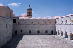 Mexico Oaxaca Santo Domingo monastery courtyard view with church Stock Photos