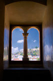 Mexico Oaxaca Santo Domingo monastery view from window with colu. Mn to town and clouds Royalty Free Stock Photography