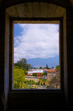 Mexico Oaxaca Santo Domingo monastery view from window to town c. Louds and mountains Stock Images