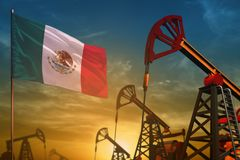 Mexico oil industry concept. Industrial illustration - Mexico flag and oil wells against the blue and yellow sunset sky background. Mexico oil industry concept vector illustration