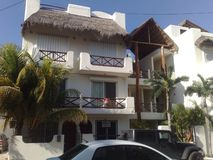 Mexico Playa del Carmen. Apartment white palm Stock Photo