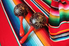Mexico poncho serape maracas Mexican traditional cinco de mayo rug poncho fiesta background with stripes. Mexico poncho serape  traditional cinco de mayo rug Stock Images