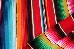 Mexico poncho serape maracas Mexican traditional cinco de mayo rug poncho fiesta background with stripes. Mexico poncho serape  traditional cinco de mayo rug Stock Photography