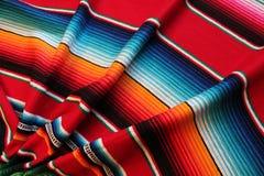 Mexico poncho serape maracas Mexican traditional cinco de mayo rug poncho fiesta background with stripes. Mexico poncho serape  traditional cinco de mayo rug Royalty Free Stock Photo