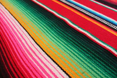 Mexico poncho serape maracas Mexican traditional cinco de mayo rug poncho fiesta background with stripes Royalty Free Stock Photography