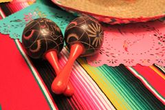 Mexico poncho sombrero maracas background fiesta cinco de mayo decoration bunting Stock Photo