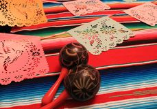 Mexico poncho sombrero maracas background fiesta cinco de mayo decoration bunting Stock Photos